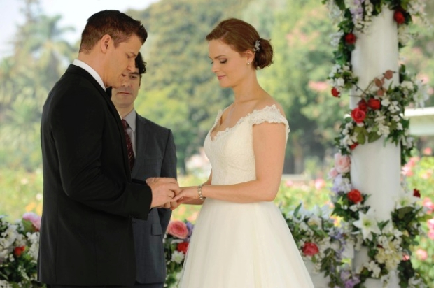what episode do bones and booth first kiss