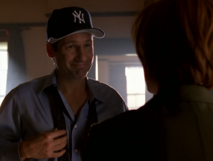 It looks like a brand new cap and I honestly can't decide which idea I like better: Scully buying it for Mulder, or Mulder buying it to tease Scully.