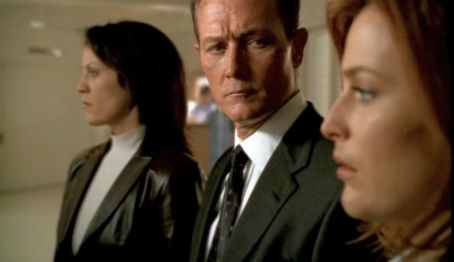 He wanted her to win like Scully wants Mulder to win. Doggett's watched Scully lose so much, and he's always impressed by her ability to keep going.
