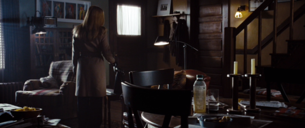It's like if Mulder's apartment became a house and Scully added some art to the walls. She definitely bought those chairs and that cabinet. He bought the old plaid chair.